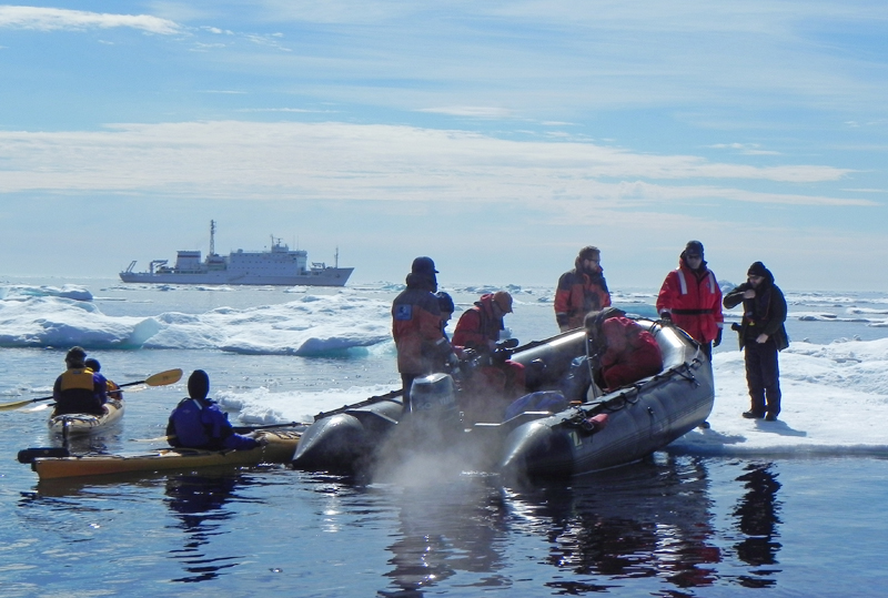 Spring in Atarctica with zodiacs and kayaks on an iceberg