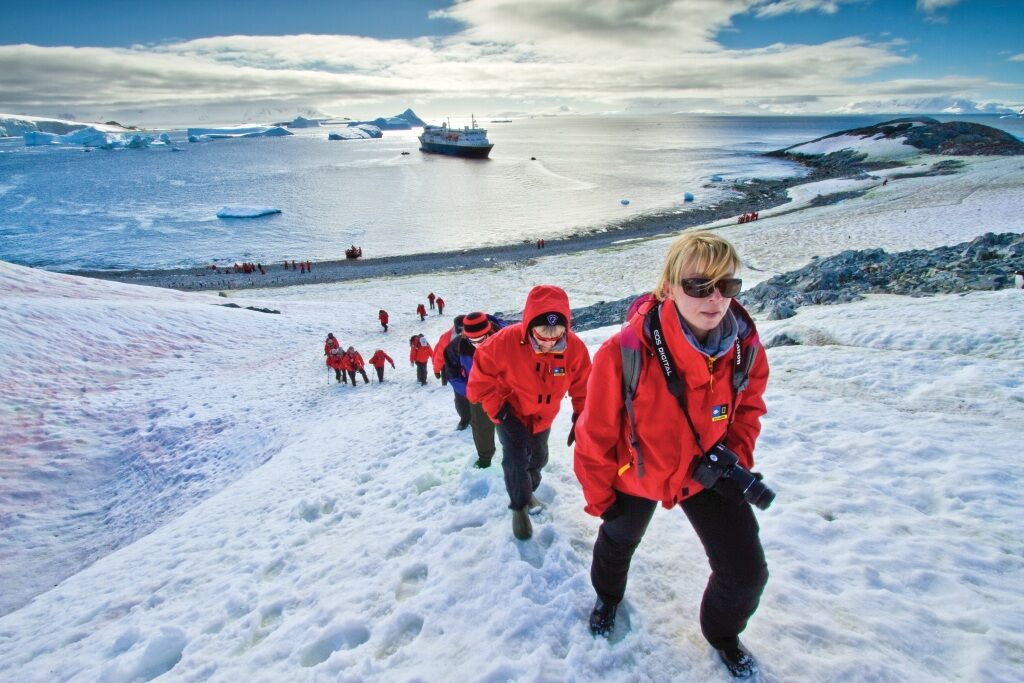 Walking up a snowy hill in antarctica