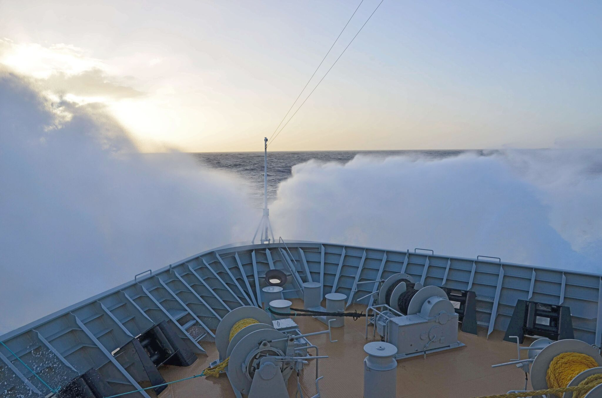 Waves crashing over the bow of an antarctic cruise vessel in the notorious drake passage
