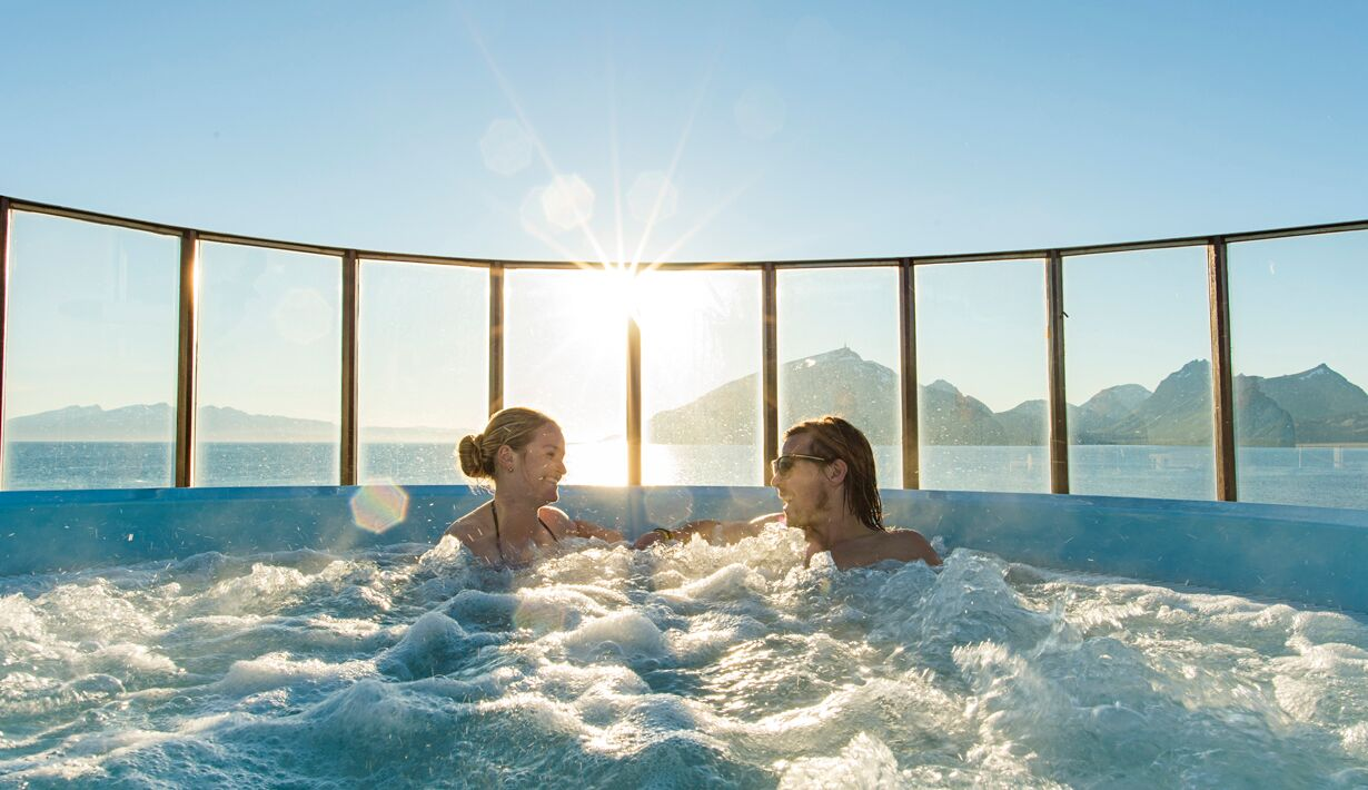 Two ladies in the hot tub on the deck of an antarctic cruise ship.
