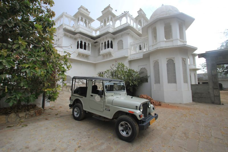 The Bera castle hotel with our safari jeep ready to take us on our next adventure