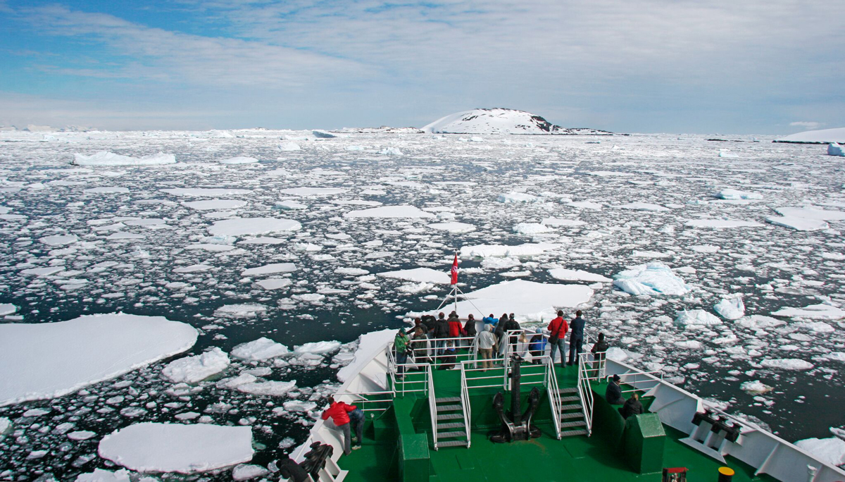 Lots of people on deck aboard an antarctic cruise vessel
