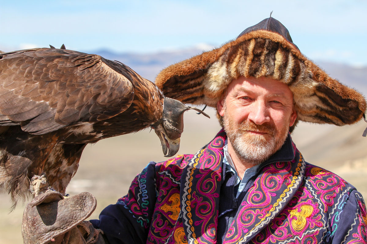 Mike Unwin-with a golden eagle in Mongolia