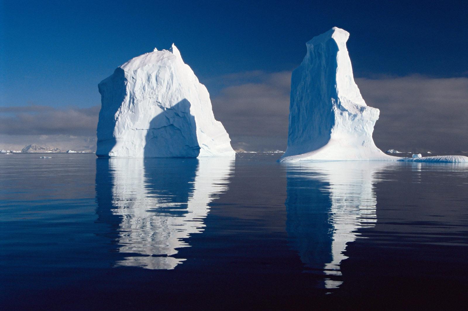 Reflection of icebergs - copyright Doug Allan